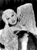 Mae West, in Beaded Dress, on Fur Rug, 1930s Photo