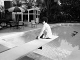 Michael Jackson at Home in Los Angeles by the Poolside, Sitting on Diving Board Photographie