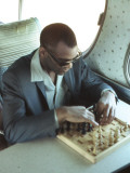 Ray Charles Playing Chess on the Tour Bus Photo