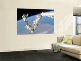 Astronaut Anchored to a Foot Restraint on the International Space Station's Canadarm2 Wall Mural