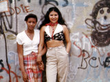 1970s America, Two Young Girls Pose in Front of a Graffitied Wall in Brooklyn, New York City, 1973 Photo