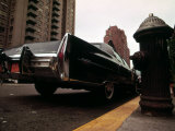 1970s America, a Cadillac Fleetwood Parked Illegally in a Fire Lane. Manhattan, New York City, 1973 Posters