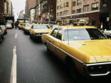 1970s America, Yellow Taxi Cabs on Lexington Avenue at 61st Street. Manhattan, New York City, 1972 Posters
