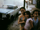 1970s America, Three Young Girls Pose in Front of an Abandoned Car in Brooklyn, New York City, 1973 Posters