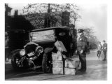 Prohibition, a Policeman Standing Alongside a Wrecked Car and Cases of Moonshine, November 16, 1922 Print
