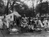 Three Sumo Wrestlers Posed Outdoors with Spectators in Background, Probably in Japan, 1905 Posters