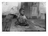 African American Child on a Dilapidated Porch, Louisiana, September, 1938 Photo
