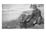 Man Panning Gold on Nome, Alaska Beach in the Early 20th Century Poster