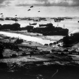 World War II, Allied Ships Landing Military Supplies on Omaha Beach after the D-Day Invasion, 1944 Photo
