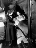American Airlines Stewardess Checks on Passenger in Sleeper Airplane, 1935 Posters