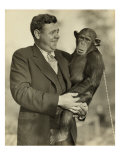 Babe Ruth, Holding Mike, a Chimpanzee at the St. Louis Zoological Park. Oct. 10, 1928 Posters