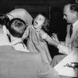 Young Girl Receiving a Vaccine from Dr. Hugh Griffin, 1950s Photo