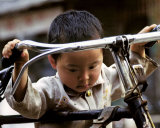Little Boy with Bike, China Posters by Philippe Body