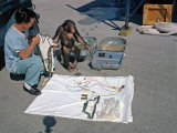 Ham the Chimpanzee and Technician Go over Equipment in Preparation for Launch, January 23, 1961 Photo
