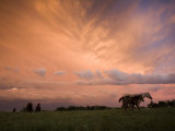 A receding thunderstorm creates a blazing sunset Photographic Print by Jim Richardson