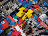 Brightly colored tents of a weekend street maket converge Photographic Print by Bobby Haas