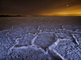 The lights of Salt Lake City brushes over the Bonneville Salt Flats Photographic Print by Jim Richardson