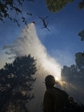 A helicopter makes water drops on a wildfire in Boise National Forest Photographic Print by Mark Thiessen