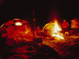 A climbing team celebrates Christmas Eve with a bonfire at base camp Photographic Print by Tommy Heinrich