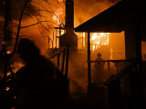 Firefighters spray down a burning house in Running Springs Photographic Print by Mark Thiessen