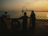 Riders on the Staten Island Ferry look out at the Manhattan skyline Photographic Print by Maria Stenzel