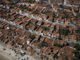 Densely packed neighborhood with traditional tile roofs Photographic Print by Bobby Haas
