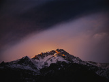 At sunset, wind scours the upper reaches of Nanga Parbat Photographic Print by Tommy Heinrich