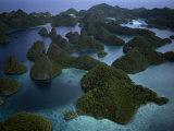 Karst islands forming Wayag Photographic Print by Jennifer Hayes