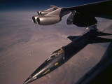 An X-15 rocket plane drops free of a B-52 Photographic Print by Dean Conger