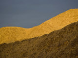 Sunset on hills at The Racetrack Photographic Print by Michael Melford