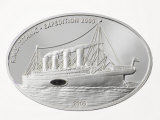 Embedded coal from the Titanic in a coin from Liberia Photographic Print by Mark Thiessen