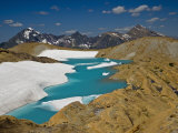 Meltwater pond at the foot of Sperry Glacier Photographic Print by Michael Melford