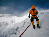 A mountain climber battles icy blasts of wind on Nanga Parbat Photographic Print by Tommy Heinrich