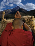 A monk prays for an end to snow leopard killings Photographic Print by Steve Winter