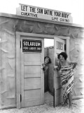 A solarium in St. Petersburg, Florida, touts the healthful effects of the sun Photographic Print by Clifton R. Adams