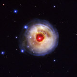 Radiation from a stellar burst ricochets off dust particles Photographie par Esa And Nasa