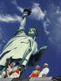 The Statue of Liberty stands tall in New York Harbor Photographic Print by David Boyer