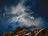 Savage winds whip Nanga Parbat's majestic Rupal Face Photographic Print by Tommy Heinrich