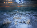 Boulders spiky with salt crystals edge the Dead Sea Photographic Print by Michael Melford
