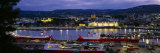 Buildings Lit Up at Night, Oslo, Norway Photographic Print by  Panoramic Images