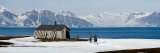 Two Hikers Standing on the Beach Near a Hunting Cabin, Bellsund, Spitsbergen, Svalbard Islands Photographic Print by  Panoramic Images