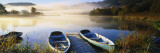 Rowboats at the Lakeside, English Lake District, Grasmere, Cumbria, England Fotografisk tryk af Panoramic Images,