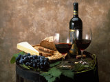Still Life of Wine Bottle, Wine Glasses, Cheese and Purple Grapes on Top of Barrel Lámina fotográfica