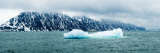 Iceberg in the Sea with a Ship in the Background, Spitsbergen, Svalbard Islands, Norway Photographic Print by  Panoramic Images