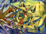 Kaleidoscopic Star Pushing Through Yellow Water with Blue Edges Photographic Print