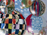 Floating Globes Filled with Reflections of Multiple Fabric Patterns Photographic Print