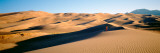Woman Running in the Desert, Great Sand Dunes National Monument, Colorado, USA Photographic Print by  Panoramic Images