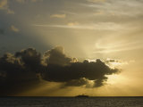 Silhoutte of a Cruise Ship on the Horizon at Sunset Photographic Print by Rick Tomlinson
