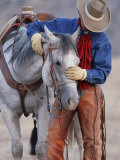 Cowboy Leading and Stroking His Horse, Flitner Ranch, Shell, Wyoming, USA Photographic Print by Carol Walker