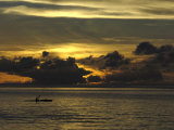 Silhouette of a Canoeist at Sunset, French Polynesia, 2006 Photographic Print by Rick Tomlinson